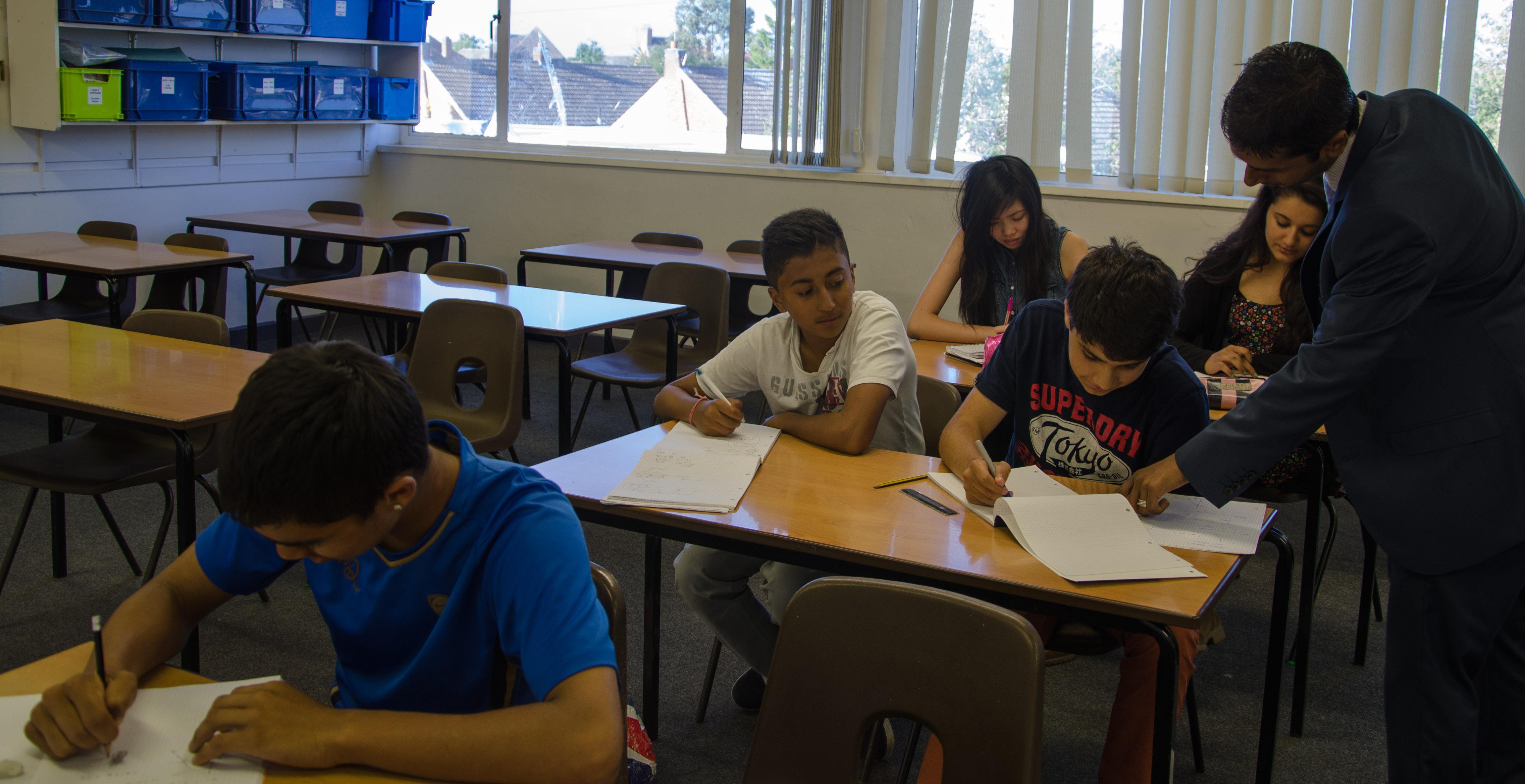 Maths tutor teaching a GCSE tuition group